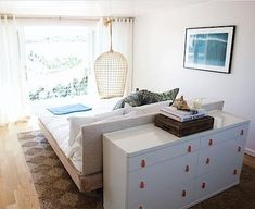 Not the hugest fan of this bedroom, but I really like the idea of straying from the typical layout and putting the headboard of the bed up against the wall and putting it in the middle of the room with the dresser against the back. Mixin it up!