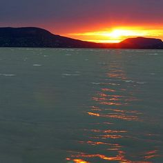 Sunset at lake Balaton with a view at Badacsony mountain #landscape#balaton#reflection#sunset#wave#sunlight#orange
