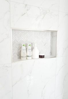 Want a marble shower on a budget? Here's how we pulled our black and white shower together for a designer, hotel look but while using big box store products.