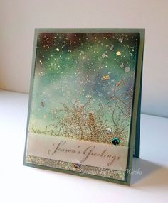 "F4A387 Winter Sky by Weekend Warrior - ""This Winter Sky stamp from Penny Black is pretty perfect for this theme! Sponged the sky with various SU inks. Looked like a hot mess but once I softened it with drops of water and added silver watercolour splatter I ended up with a snowy night sky...yay! """