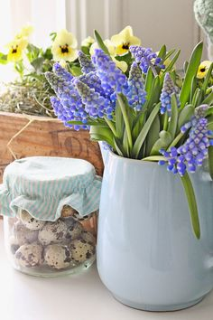 Pitchers as vases are a favorite.  Lots of great photos of this light blue one with grape hyacinths.  ~ Mary Wald's Place - VIBEKE DESIGN: I en grønn og blå verden....