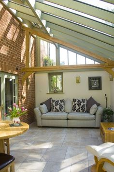 A pretty conservatory in the traditional lean-to style. Features include an oak beam, Farrow and Ball colouring and wooden cladding to the back of the building. Conservatory Interiors, Conservatory Dining Room, Lean To Conservatory, Conservatory Design, Conservatory Ideas Interior Decor, House Extension Plans, House Extension Design, House Design, Window Frame Colours