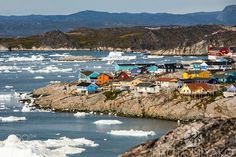 Houses of Ilulissat http://ift.tt/1OsYL74 shoreFjordIlulissatPhotomiyakoarchitecturebeautifulblackbluecitycolourgreenlandhouseiceoceanseasnowtravelwater