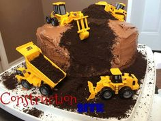 CONSTRUCTION SITE CAKE   -   2 boxes of cake mix icing oreo crumbs construction toys  Make 2 cakes according to directions and put them together. Ice cake. Cut your chunk out of the side and decorate with oreo crumbs. Your kids will love this!!