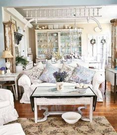 Shabby Chic Style Living Room And White Sofa And Vintage Coffee Table And Floral Rug And Pillows #vintagecoffee