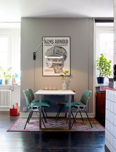 small apartment interior design dining room chairs green lamp light lighting grey
