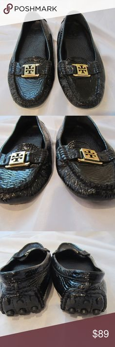 Tory Burch Kendrick 7 Driving Moccasins Black Shoe Tory Burch Kendrick Driving Shoes.  Black Patent leather with gold logo on front.   Size 7.   Excellent condition but PLEASE NOTE LAST PICTURE.  There is a small scuff on the outside of the right shoe.  This isn't noticeable, but wanted to mention it.  Please see 3rd from last photo where it isn't noticeable.   If you would like more pictures let me know.   I had to take a picture of the shoe upside down so I could even capture a picture of…