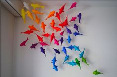 Or maybe origami koi...  Wouldn't this look great on a blue wall?  You could even paint a little muted koi pond mural.