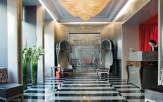 We are a global and creative design studio in Geneva, Tokyo and Beijing. Lobby Design, Design Hotel, Patterned Chair, Silver Walls, Interior Architecture, Interior Design, Velvet Armchair, Waiting Area, Paris Restaurants