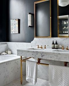 Lovely bathroom with marble, black contrast wall and deep gold! Love it! From House and Garden Magazine UK @houseandgardenuk #marbleandgold #gold #marble #blackcontrast #interiorinspiration #interior #interiør #inredning #wollinghome