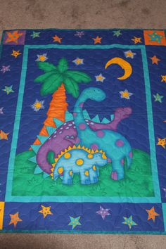Check out this item in my Etsy shop https://www.etsy.com/listing/221362719/dinosaur-baby-quilt