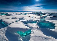 """""""In March, due to a natural phenomenon Siberia's Lake Baikal is particularly amazing to photograph. The temperature, wind and sun cause the ice crust to crack and form beautiful turquoise blocks or ice hummocks on the lake's surface.""""  Photograph by Alex El Barto."""