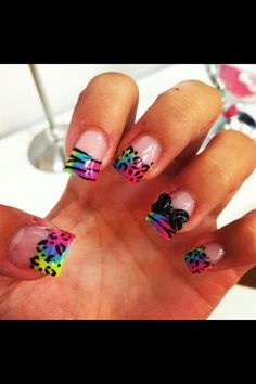 Animal Print Acrylic Nails with rainbow ombré colors as the background