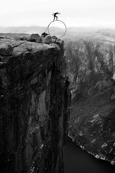 """If you're afraid of heights, this will definitely rattle your nerves! 30-year-old Eskil Ronningsbakken performs dangerous balancing acts. Risking death at any given moment, the Norwegian rides bicycles upside down, balances on chairs over cliffs, and on stands ice thousands of feet high. """"That's the balance between life and death, and that is where life is."""" he says."""