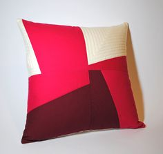 Feel like this ivory, raspberry, pink (?) throw is a color block accent winner