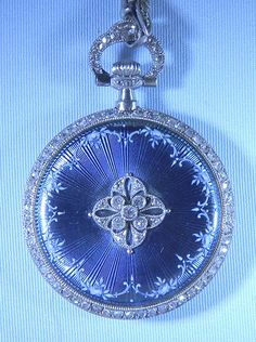 Fine and beautiful Patek Philippe 18K gold, platinum, diamond and enamel ladies antique pendant watch with matching chain circa 1910. The case back in lavender-blue enamel over engine turning with diamond central design. Diamond bezels, pendant and bow