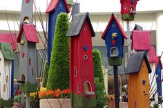 Birdhouses  a multitude of them in your favorite space the garden.
