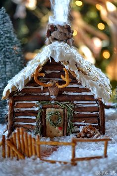 Three Pixie Lane: Gingerbread Log Cabin - I cannot stand how CUTE this is! Especially love the pretzel 'antlers'!