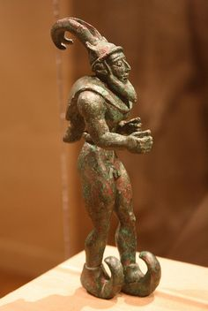 A Magnificent and Important Proto-Elamite Arsenical Copper Striding Figure with Ibex Horns, a Raptor Skin Draped Around the Shoulders, and Upturned Boots | Flickr - Photo Sharing!