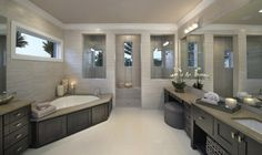 great focal shower with multiple windows in windows and stunning tile!-Castle Harbour homes