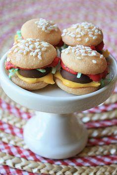Burger Bite Cookies (vanilla wafers bun, Hershey's kiss meat patty, coconut lettuce, royal icing ketchup, mustard)