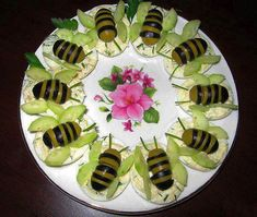 butterflies sitting on top of deviled eggs - butterfly made with black/green olives and cucumber