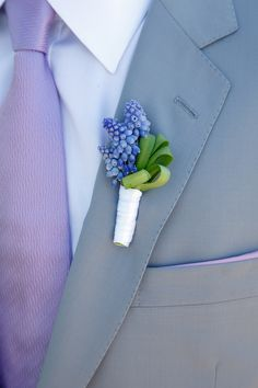 Boutonniere: - for dad? --- The groom's boutonniere, of grape hyacinths tied with a white ribbon, accents his light purple tie. Purple Wedding, Trendy Wedding, Spring Wedding, Floral Wedding, Wedding Colors, Dream Wedding, Wedding Beach, Wedding 2015, Wedding Reception