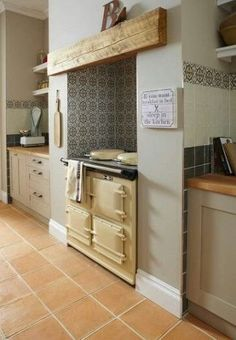 Tiles alcove for aga, with plain tiles by worktops. Could have a theme going. Cottage Kitchen Tiles, Aga Kitchen, Taupe Kitchen, Kitchen Wall Tiles, Shabby Chic Kitchen, Farmhouse Kitchen Decor, Country Kitchen, Kitchen Ideas, Country Living