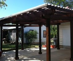 pergola carport with clear corrugated top. http://oklahomaoutdoorliving.com/wp-content/uploads/2012/05/carport1-478x400.jpg