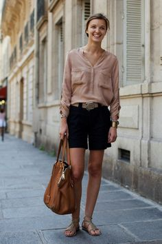 Mauve shirt, black shorts, gray sandals, beige belt, camel handbag