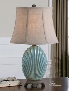 """Gorgeous blue ceramic with crackle glaze and rust rubbing gives this little beauty the feeling of a treasured antique. Excellent details in the linen shade that's lined and created with precision. Uttermost Seashell Blue Accent Lamp 23""""H : 29321 