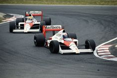 Ayrton Senna Photos Photos - Alain Prost drives the Marlboro McLaren-Honda MP4/5 ahead of his team mate Ayrton Senna just before the two drivers would contoversially collide during the Japanese Grand Prix on 22 October 1989 at the Suzuka Circuit in Suzuka, Japan. - (FILE) In Profile: Ayrton Senna