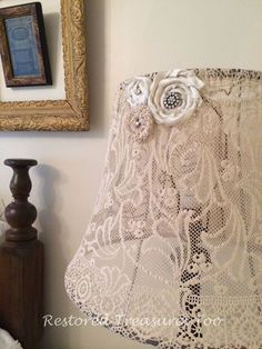 Junkyjoey Create some charm by covering a lamp shade with a vintage lace table cloth and embellishing it with vintage brooches!