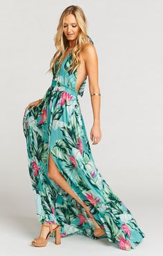 Absolute perfection. Vacation Maxi is that girl who walks in a room and everyone can't just help but stop and stare. With her deep v-neck halter and slit in the front, she grabs everyone's eye everywhere she goes. The perfect travel buddy for when you just don't know what to expect!   *MADE IN THE GORGE USA* *100% Rayon *Mumu cloud fabric is dry clean only. Do not wash *Ties at neck *Elastic Waist *Lined, Top front only *Side Slit