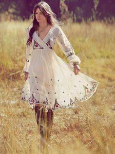Free People New Romantics semi-sheer gauze empire dress with embroidery, long bishop sleeves, full gathered skirt, and lace on the surplice bodice.