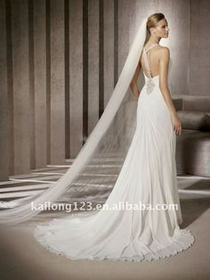 Different sort of front but with a brooch-style feature, and the T-back look