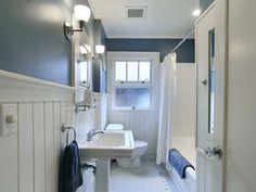white with dark accent color keeps bungalow bathroom fresh Bungalow Bathroom, Craftsman Bathroom, Wainscoting Bathroom, Long Narrow Bathroom, Small Bathrooms, Bathroom Layout, Bathroom Ideas, Downstairs Bathroom, Bathroom Vanities