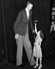 Robert Wadlow, World's Tallest man, with Miss Angela Rizzo, 19. ca.1940.