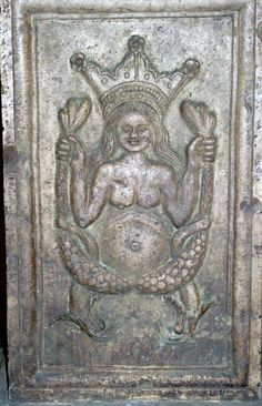 Queen of the sirens on a building of the Baptistery of Pisa