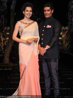 Fashion designer Manish Malhotra with B'wood actress Kangana Ranaut on Day 1 of the Lakme Fashion Week (LFW) Summer Resort 2014 , held at Grand Hyatt, Mumbai, on March 11, 2014.