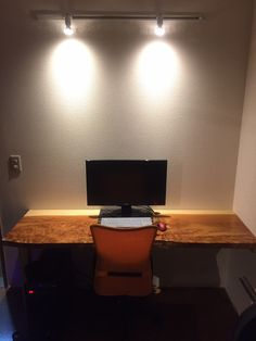 Cedar desktop with halogen rail lights.