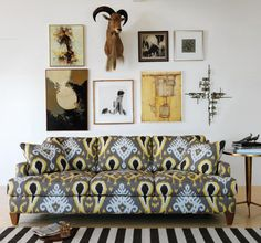 Gray ikat couch - love the mix of ikat with stripes. Great use of patterns!