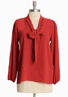 bow blouse in a bright color