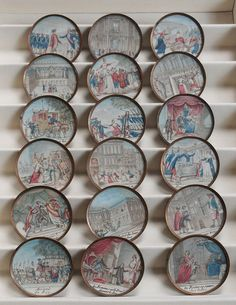 ButtonArtMuseum.com - Rare and large collection of French Revolution commemorative buttons, circa 1790, Paris, each with engraved title of event depicted at bottom, hand-colored stipple engravings on bezel set in copper...