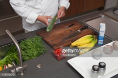 Stock Photo : Mid- adult chef prepares fresh food