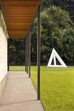 Residence 1414 Looks Great After Being Remodeled By Miro Rivera Architects Outdoor Sculpture, Outdoor Art, Outdoor Spaces, Outdoor Living, Outdoor Decor, 1940s Home, Texas, Dark Interiors, Sliding Glass Door