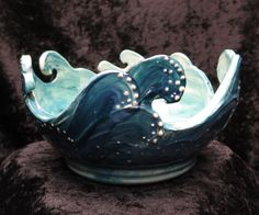 This Ocean Waves Yarn Bowl has rhythm because it has different shapes to make up one bowl