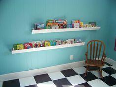 Rain gutter bookshelves. I really like this idea - seems like it would hold a lot of books.