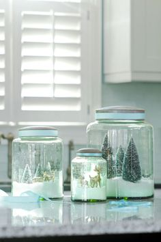 DIY Green Glass Snow Globes - cute idea.  I could make a who winter wonderland!