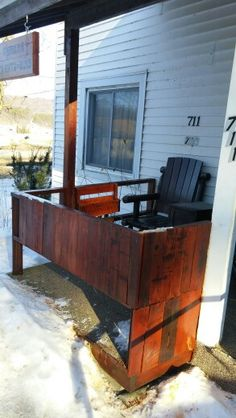 Encasing my boring porch with reclaimed pallet wood. Cedar color stain , then outdoor minwax polyurethane. Great color.